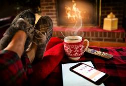 Image of someone relaxing in front of a fireplace