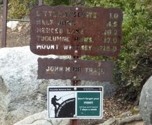 John Muir trail signs remind hikers to carry their permits