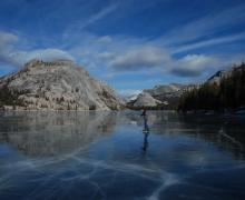Image of an ice skater on Tenaya Lake